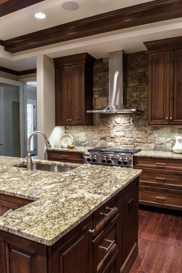 Kitchen Backsplash Ideas For Dark Cabinets  Custom wood cabinets and gray stone countertops are top