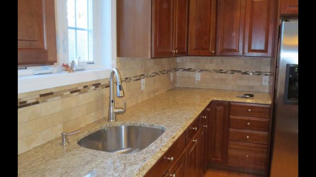 Kitchen Backsplashes Subway Tile  Travertine subway tile kitchen backsplash with a mosaic