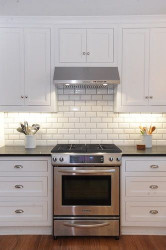 Kitchen Backsplashes Subway Tile  White kitchen cabinets with white subway tile backsplash