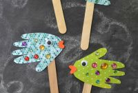 Simple Kids Crafts Lovely Handprint Fish Puppets Kid Craft Glued to My Crafts